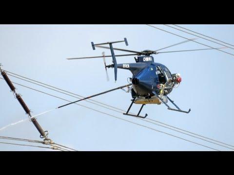 необычное, знания - Для чего опоры ЛЭП поливают из водяной пушки с вертолета? Ответ в этом видео