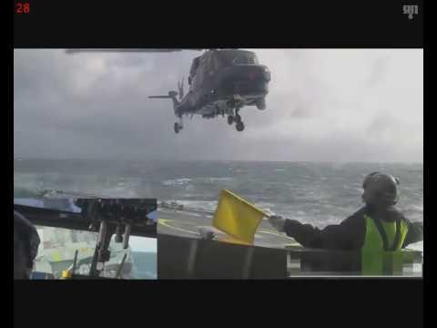 Посадка вертолета на палубу корабля в сильный шторм